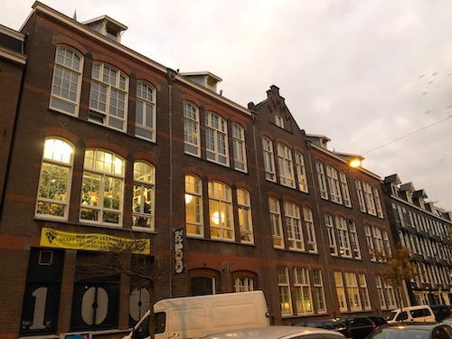 A guided tour for 2 people in a former famous squat in Amsterdam, including a healthy meal and an obscure concert.
